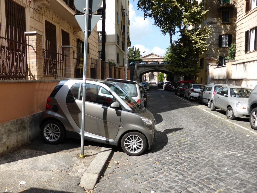 "The little ""smart"" cars are parked everywhere"