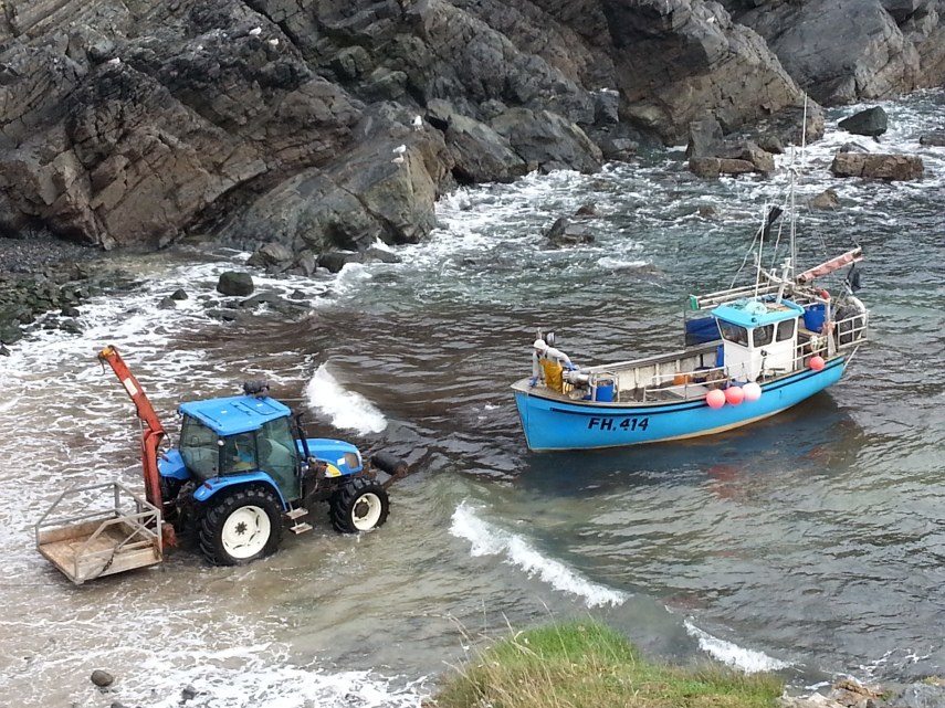 Tractor pulling a fishing boat