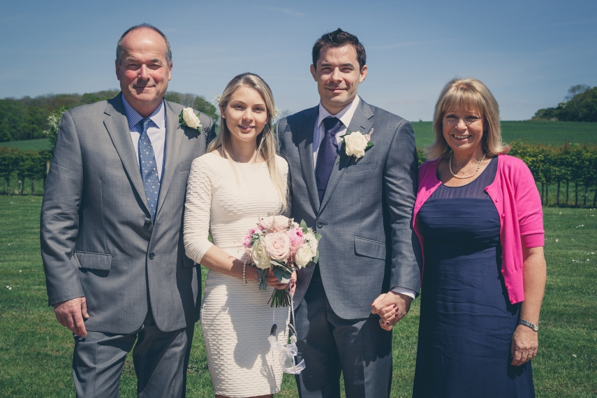 With groom's parents, David and Vanessa