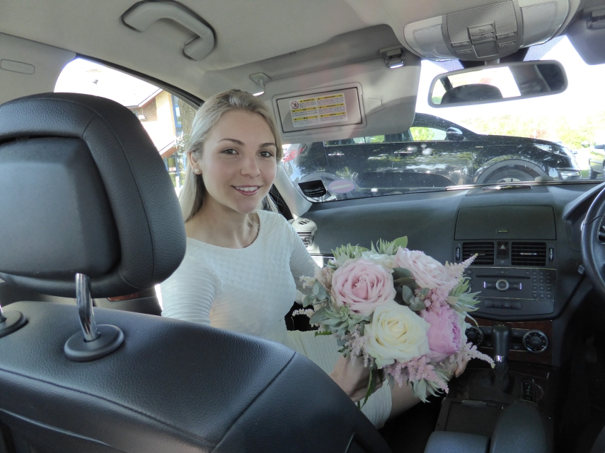 Bride waiting nervously in the car before the ceremony