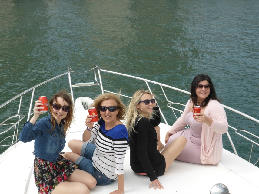 The girls had fun sitting at the front of the boat