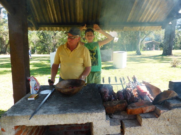 My father and nephew preparing a Sunday barbecue