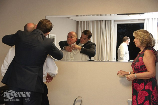 Groom getting ready at his parents hotel
