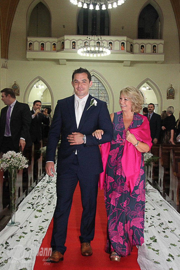 Groom enter the church with his mother