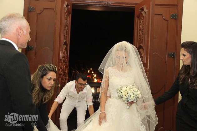 Bride arrives fashionably late with her entourage of hair and make up
