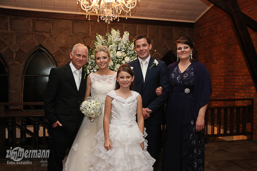 With her father, step mother and half sister