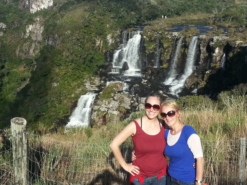With my sister at the other side of the falls