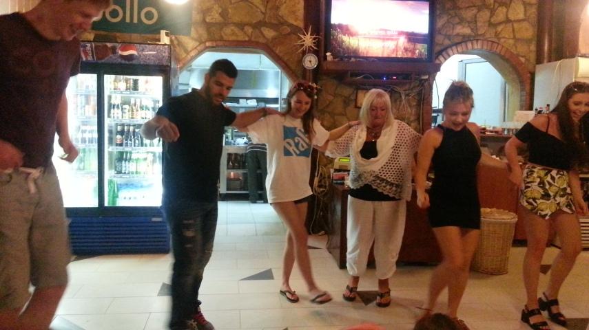 Chloe getting Greek dancing lessons