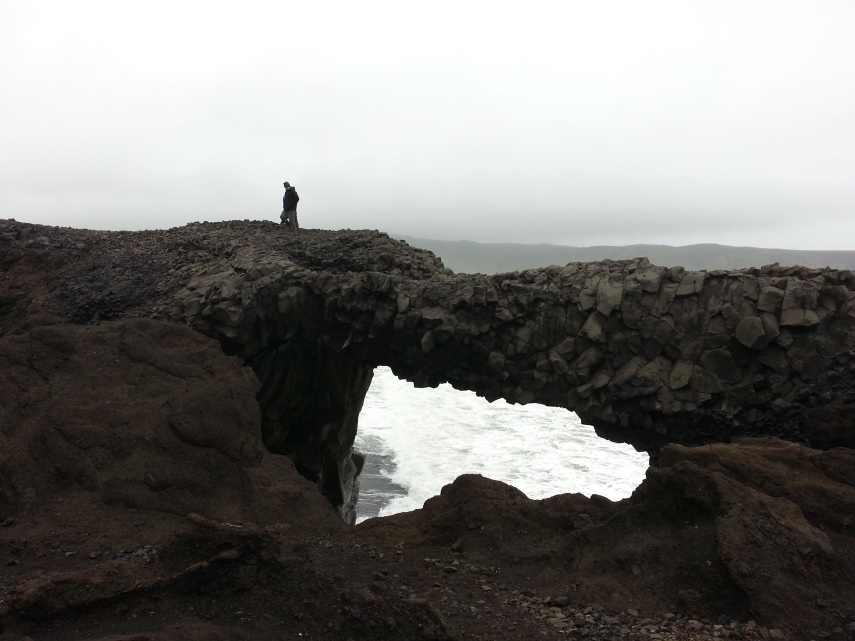 Brian braved the hauling wind and climbed over this arch