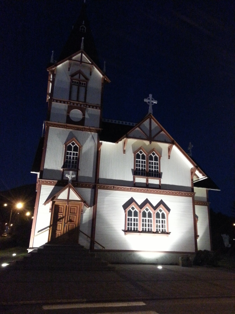 Husavik's main church all lit up at night