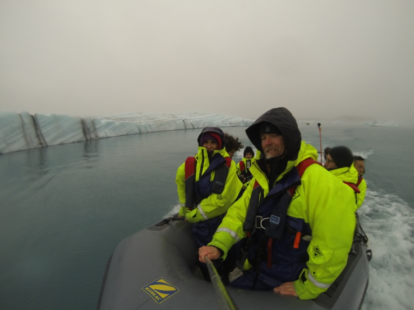 Waiting at the edge of a glacier as our guide explains our risks of getting too close